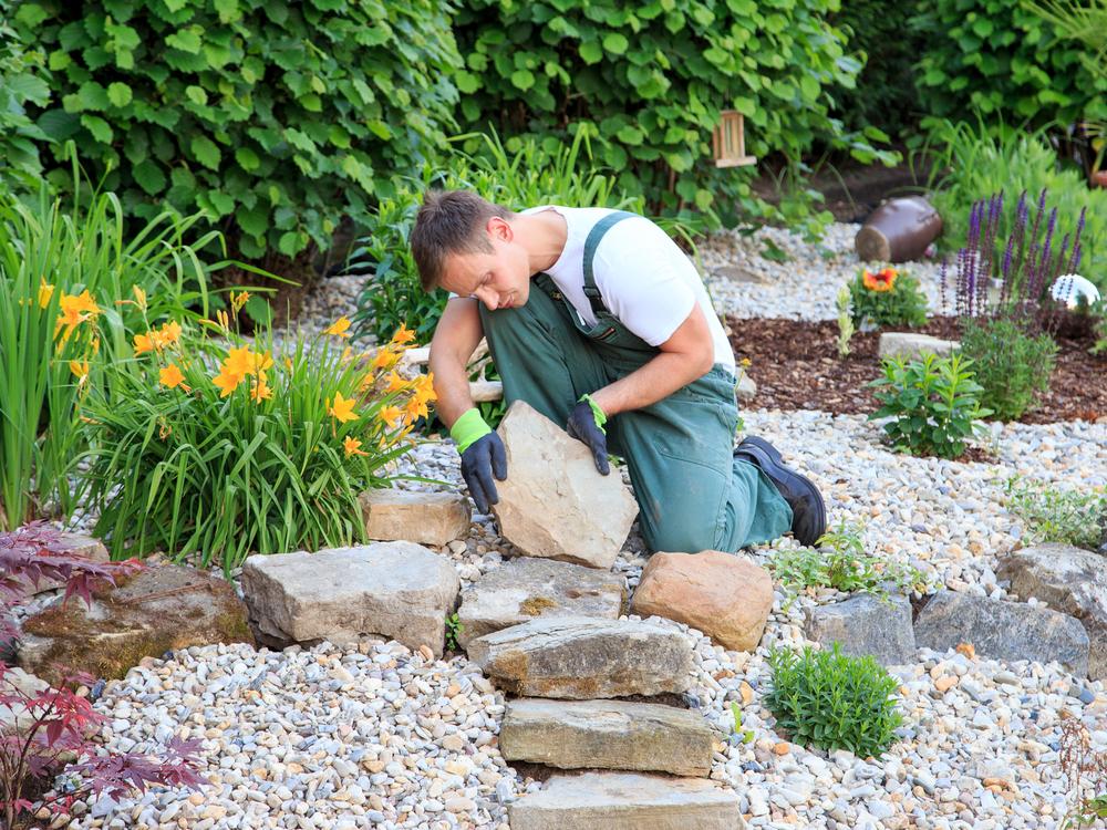 man landscaping garden