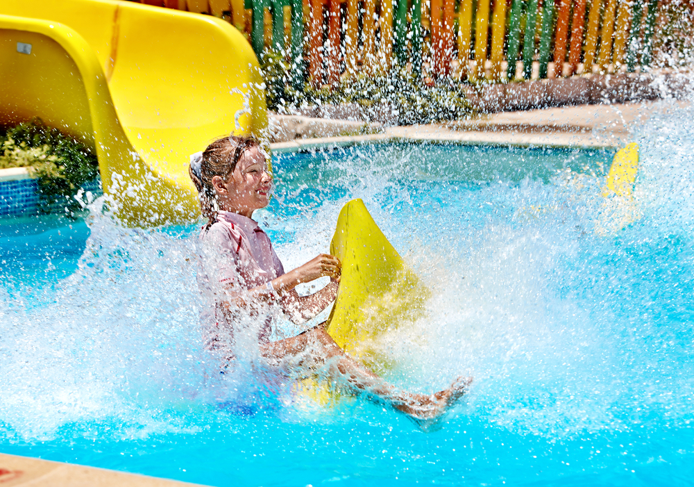 fun home pool with slide and aqua toy