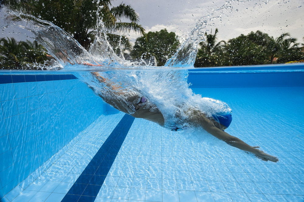 swimmer jumping into water