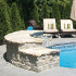 rock wall surrounding pool
