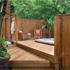 Fence surrounding hot tub